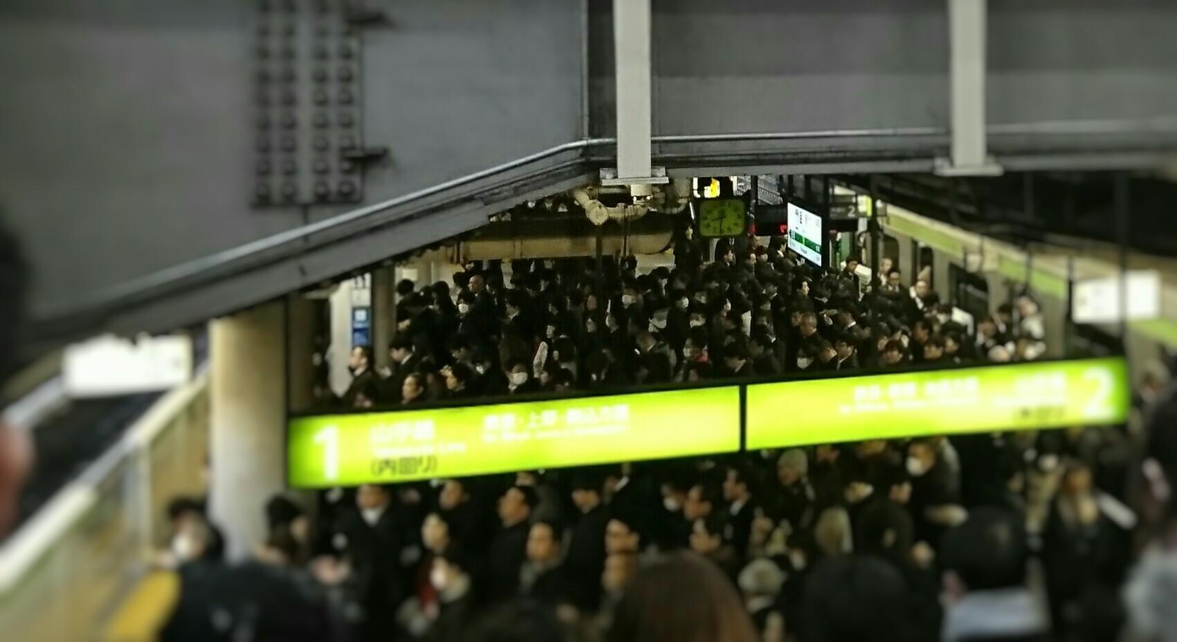 many people in rush hour at Shinagawa station